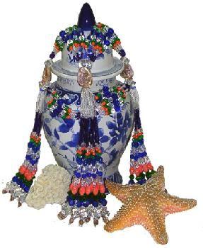 Olokun vase with mazo collar.