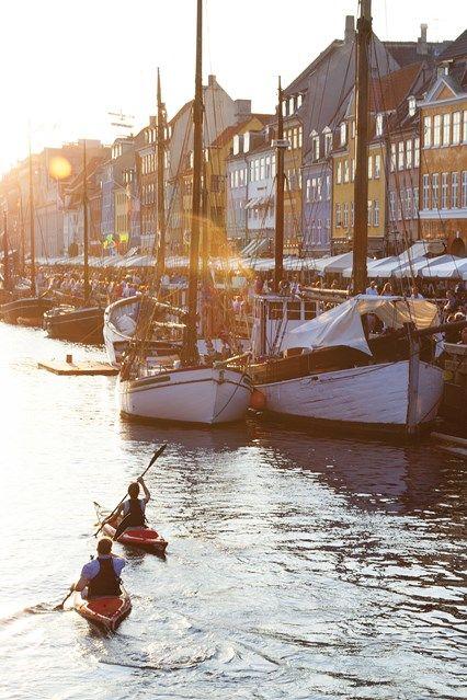 Paddling down the river in Nyhavn in Copenhagen, Denmark Cool things to do in Copenhagen (Condé Nast Traveller)