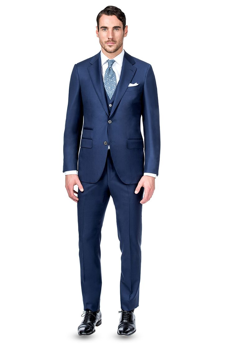 Not Brennen's exact suit, but similar to this 3-piece w/ticket pocket. He's deciding between bowtie or a tie.