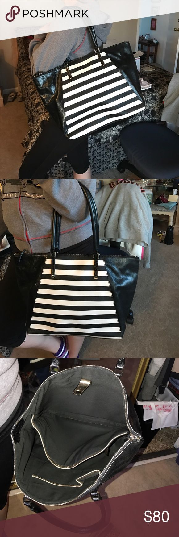 Black and white leather tote bag Black and white stripe leather tote back suitable for a laptop used one time. In amazing condition. Banana Republic Bags Totes