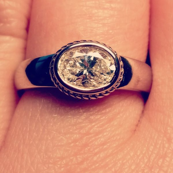 oval shaped diamond engagement ring with east-west orientation