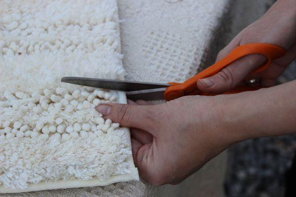 DIY moroccan wedding blanket... she used a shag bathmat.. yup good idea.
