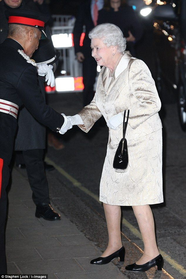 The royal greets a Claridge's staff member on arrival at the event. She was set to spot a familiar face among the finalists as James Parums who works at Buckingham Palace was among the contestants