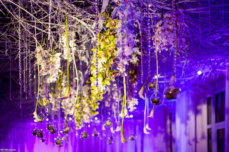 Flower garlands with ornaments. Purple light