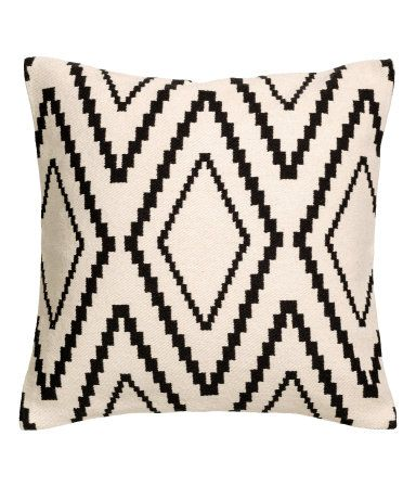 Natural white. Cushion cover with a jacquard-weave front and solid-color cotton canvas back. Concealed zip.