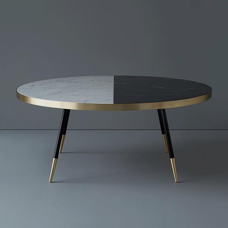 British designer Bethan Gray mixes marble and brass to create this cool coffee table