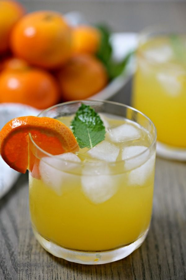 This Tangerine Mojito from CookingInStilettos.com is a citrusy twist on a classic mojito recipe.  Fresh tangerine juice is muddled with rum, mint, and Tropicana Tangerine Lemonade for the perfect sunshine inspired cocktail, fabulous for last minute entertaining! #MixedWithTrop #Sponsor