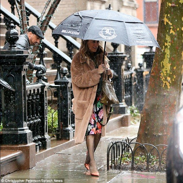 Rainy days: Sarah Jessica Parker braved the elements on Friday, heading out into the driving rain on her way to a Q&A session for her HBO series Divorce