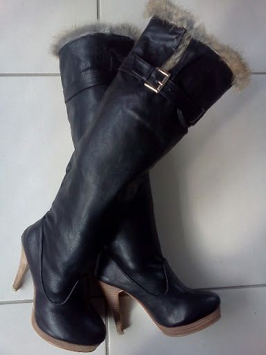 Fur Top Ladies PU Leather Boots size Eu35, Au4, US5 only-New Black Knee High PU-Leather. Labelled Size 35 (actually AU 4)  -Length from toe to back of heel insole 22.5cm - Circumference at ankle 27cm -Width of sole at widest point 6.5cm  -platform 2cm high -Heel height at back of boot 10cm  -Total height from floor to top of boot 50cm (rolled down 44cm) -Outer Circumference at widest calf point 34cm -Outer Circumference at the top 35cm (with built in split at top).
