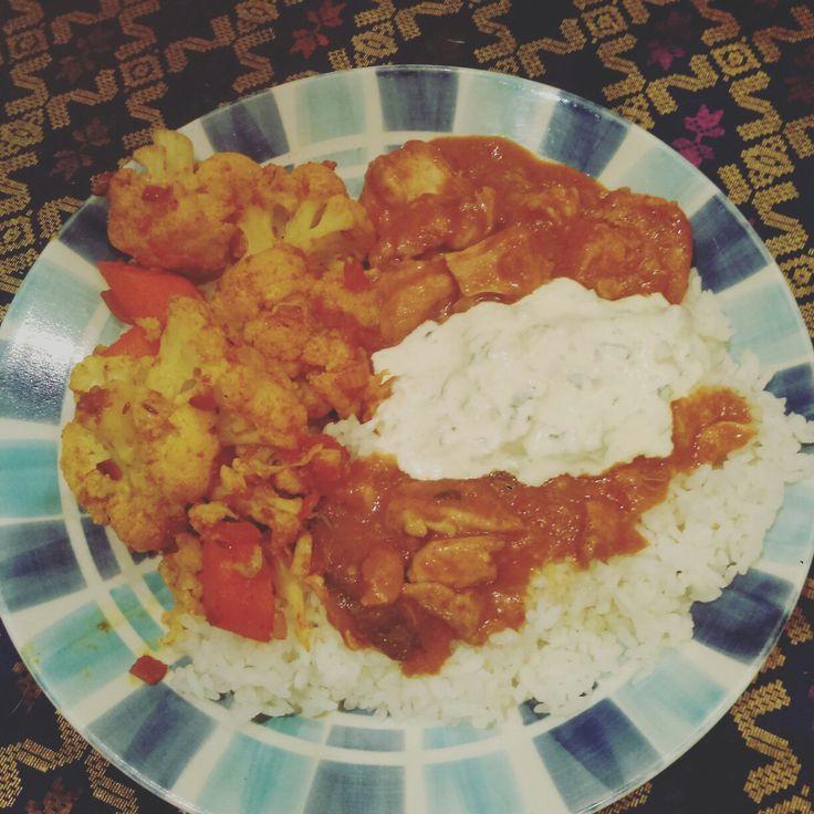 Slow cooked chicken tikka masala, aloo gobi and raita