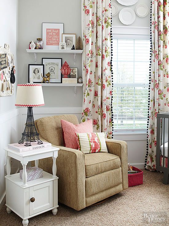 Curtain Call Handmade curtains made with affordable floral fabric and black pom-pom trim extend above the windows to take advantage of vaulted ceilings in the child's room. Glass plates fill the gap between the rod and the window, while crisp white beaded board and a chair rail ground the tall space.
