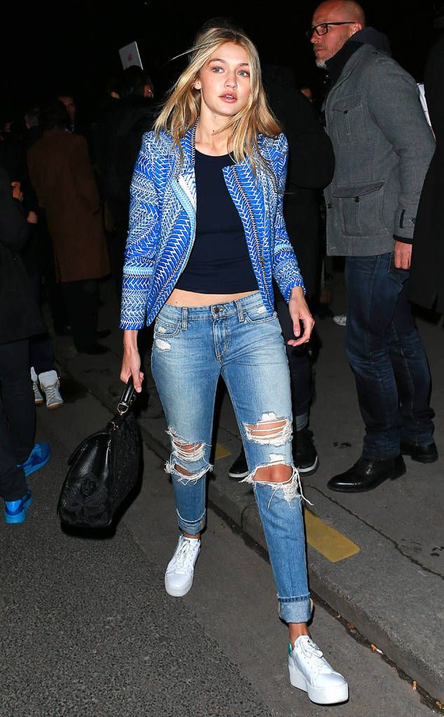 Blue Belle from Gigi Hadid's Street Style  The 20-year-old steps out in Paris wearing distressed jeans, platform trainers and a gorgeous printed jacket.