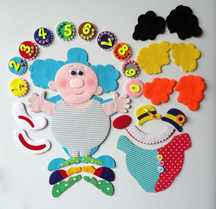 Здравствуйте, дорогие рукодельницы, хочу вам показать еще один магнит, точнее набор магнитов, в набор входят : клоун, цифры для жонглирования от 0-9, две пары ботинок, две шляпы, один комбенизон, один воротничок, один красный нос, три парика, ну и грустная и веселая улыбка. Вот варианты внешности: