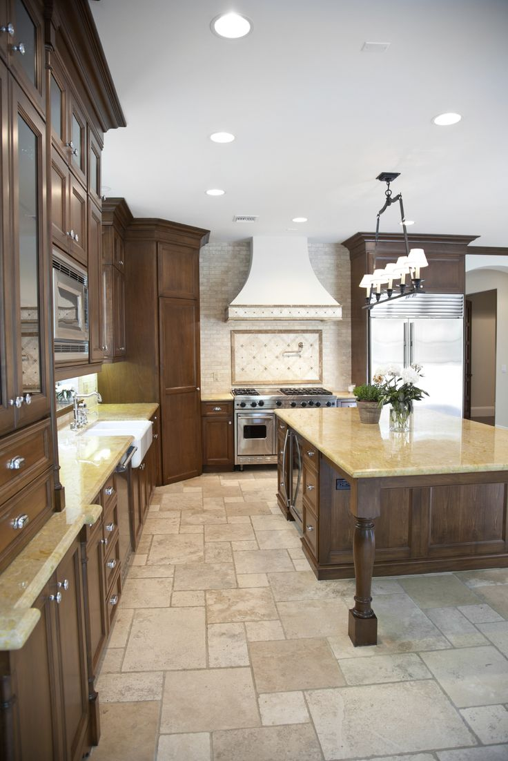 Light Stone Flooring Makes The Natural Wooden Cabinets And
