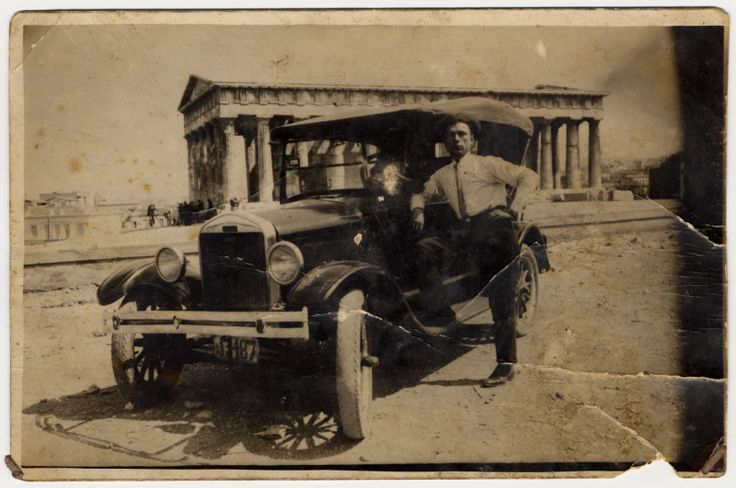 A Greek Jewish man stands next to his automobile parked in front of the Temple of Hephaestus (Thiseion).  Pictured is Elia Ackos, the uncle of the donor.