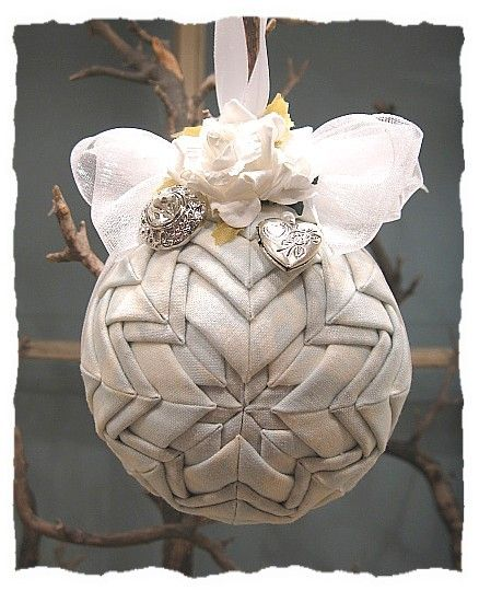 Turn your wedding dress into an ornament, with your earrings.