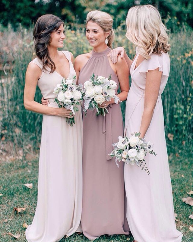 Loving the dusty mauve and taupe palette of these @joannaaugust dresses. Check out this classic wedding on the blog today! link in bio. // photo @mikecassimatis // florals @bloominbuckets