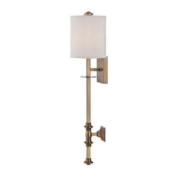 Beautifully warm brass brings even more shine to the handsomely structured and detailed this wall sconce.