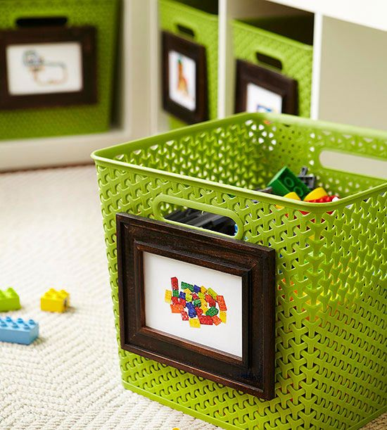frames with pics attached to baskets for toy storage