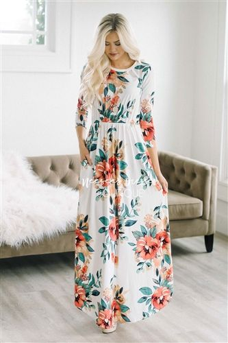 Our super soft floral dresses just got a make over! Now coming in floor length, this maxi dress is as pretty and comfortable as they come! Pretty ivory maxi dress features a cute tropical floral print, elastic waist, 3/4 length sleeves and pockets!