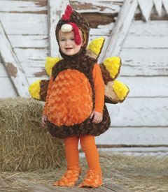 baby turkey costume. Would be great with dad as hunter & mom as chef & stick a butterball label on turkey's tummy....or...parents as pilgrims/indians.
