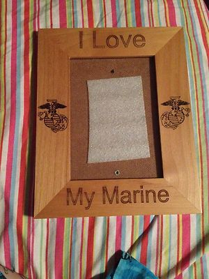 """I love my Marine picture frame"" This item is posted on eBay. I am selling it because me and my ex-fiance are no longer together. I am also going to post shirts I screen printed myself to wear to see him so that I wouldn't have to wear shirts that looked like all the other Marine Girlfriends/Wives. So keep a look out for those if you wear a small/medium. (:  USMC; Marine; Marine Wife; Marine Girlfriend; Marine Fiancee; Picture Frame; Love; Marine Life; I love my Marine"