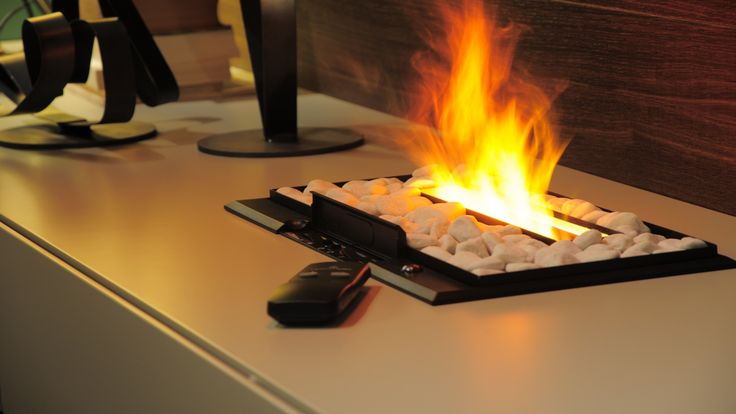 The electric fireplace produces only water vapour and the optical illusion of a fire, not heat.