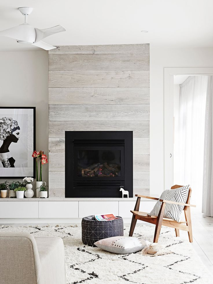 "**Place a stylish chair by the fire –** and don't forget a good book too! Now just sit back and enjoy all the cosy pleasures that winter has to offer. See more of this [east Melboure home](http://www.homestolove.com.au/gallery-scandi-style-renovation-brings-bungalow-to-life-2053|target=""_blank""). Photo: Eve Wilson / *real living*"