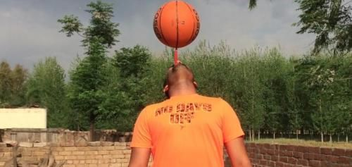 Man spins basketball on a toothbrush for world-record 53 seconds