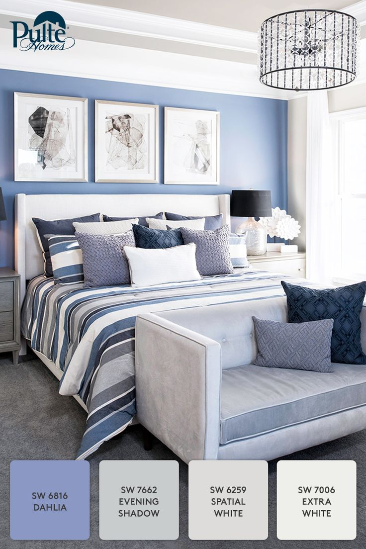 On trend for winter: A bedroom with a beautiful case of the blues! Accents and decor dressed in cream and cool blue hues create a serene space for you to rest and relax. | Pulte Homes