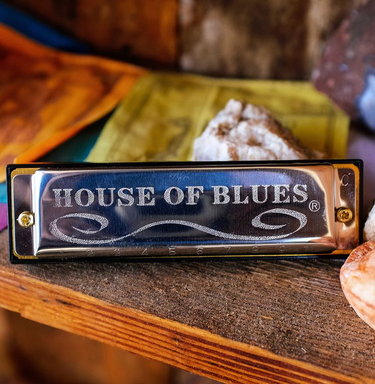 Click To Discover Rockstar Gear | Stainless steel HOHNER harmonica in the key of C with House of Blues engraved on one side.