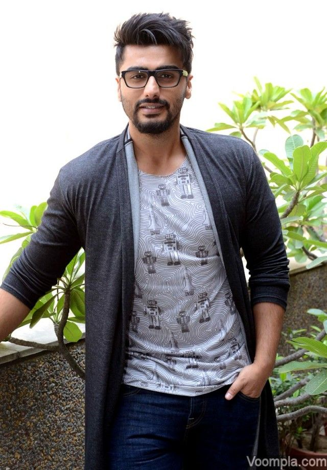 Arjun Kapoor goes geeky in Prada glasses and a funky haistyle to match. via Voompla.com
