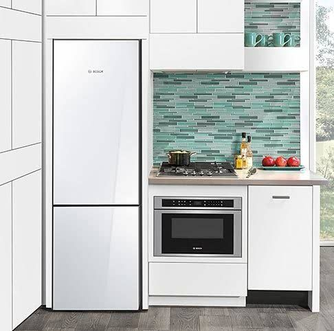 Built in fridge, flush mount hood and cooktop with wall oven built underneath - must use same manufacturer for cooktop and oven for this to work