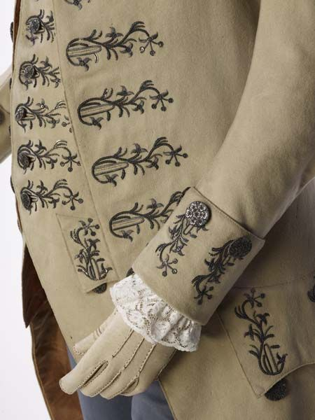 Detail embroidery, 3-piece suit, England, 1766-1775. Fawn-coloured broad cloth (woollen fabric) with silver thread embroidery around the buttonholes.