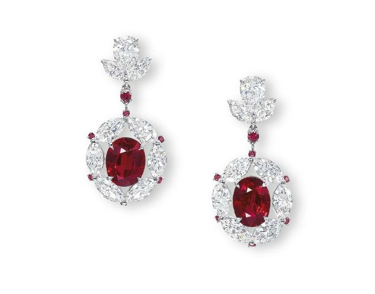 """A pair of rare 5.23 and 5.13 carats Burma """"pigeon's blood red"""" ruby and diamond ear pendants. © Christie's Image 2011"""