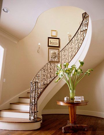 Sculptural Staircase  The best stairways are works of art, such as this serpentine piece that coils as it rises. Building these stairs combined the skills of various artisans who work with wood, metal, and drywall.