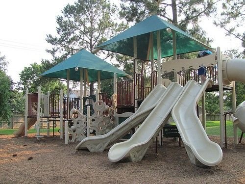 Three tall slides at the large playground. Mabry Mill Park in Clear Lake, Texas (Houston suburb).    Photo by sikeri via Flickr.