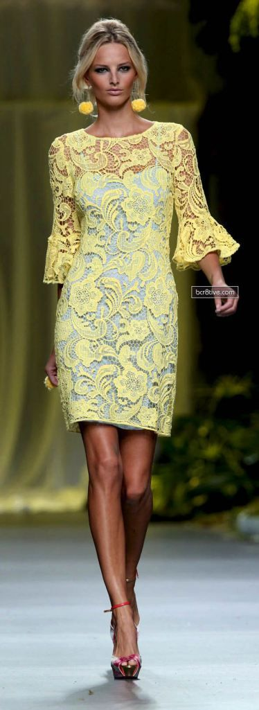 Blue dress with yellow lace overdress.