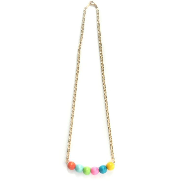 Gumball necklace. Colorful wooden beads and a gold plated chain. Mallory