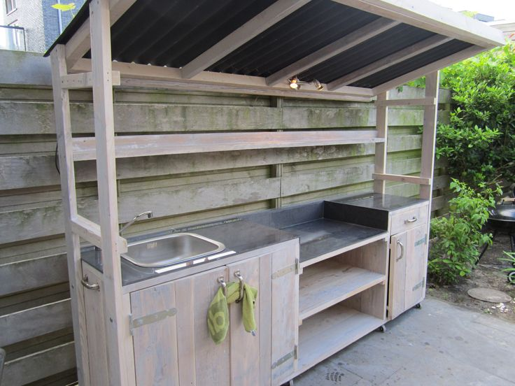 Love that this simple outdoor kitchen is covered. I need to enclose it completely with doors on the front.