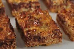 Magic Bars - Easy squares recipe with condensed milk, choc chips, walnuts, graham crumbs, coconut, margarine; no mixing required -- try this one for the family reunion tomorrow!