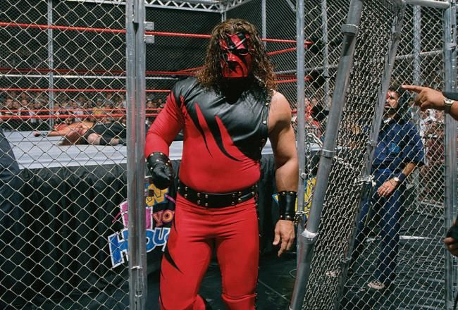 Kane leaves the Hell in a Cell cage through the door he'd dismantled, after giving the Undertaker a tombstone. Hell in a Cell, 1997 Bad Blood, Kane's debut!