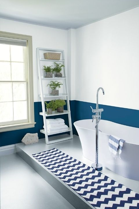 The window trim in this bathroom was painted in Hazy Skies to add a dose of warmth to the cool palette.
