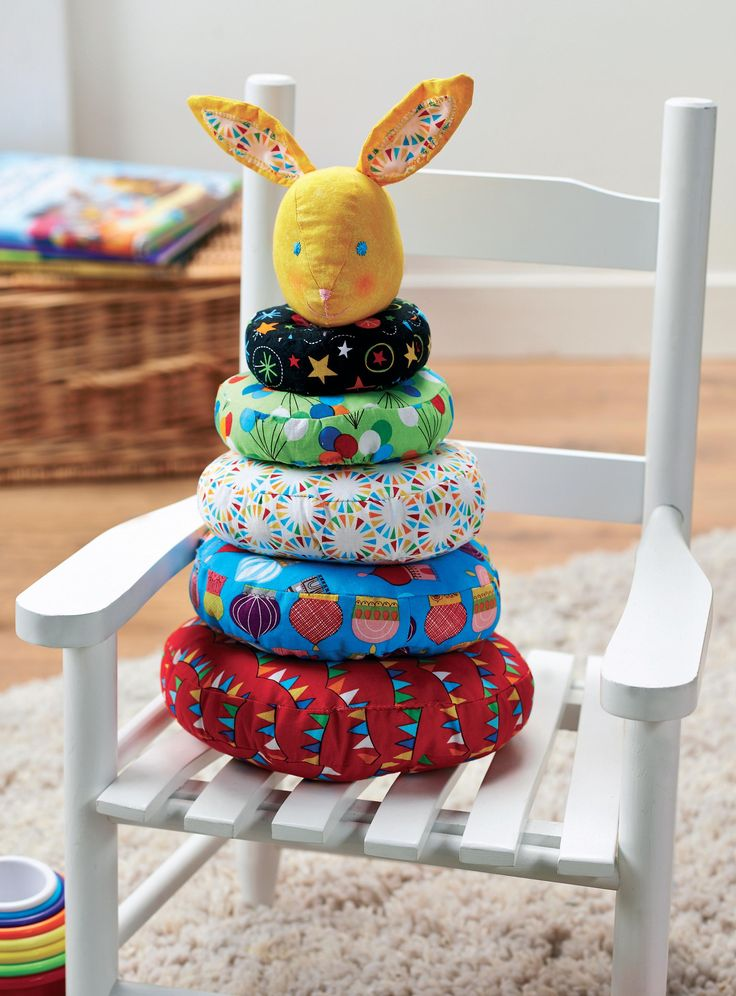 Stacking rings are a classic toy for toddlers and what little one could resist this rosy-cheeked bunny, poking its head out of a colourful burrow? These doughnut-shaped rings are a great way of busting your stash using an array of jolly fabrics.