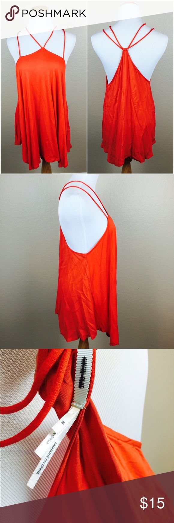 Kimchi Blue Strappy Orange Top Lightweight Orange/Red blend Strappy top by Kimchi Blue. Size M. In like new condition. Has blacked out tag. Asymmetrical hem. Breathable soft fabric. 100% Rayon. Urban Outfitters Tops Tank Tops
