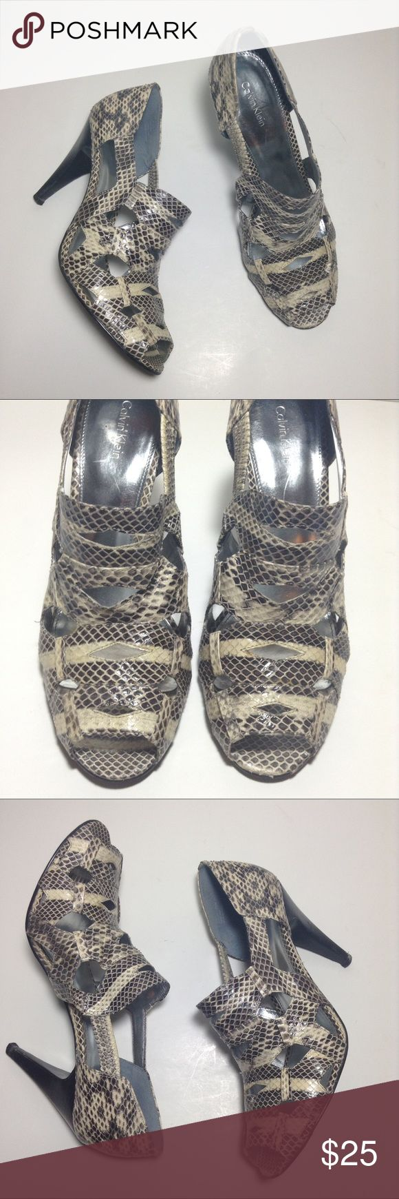Calvin Klein Caged Strappy Heels Animal Print shoe Calvin Klein caged/cut-out Strappy animal print heels shoes. Size 9.5. Pre-owned in great condition with some wear mainly on soles. If you have questions, please leave a comment below. Calvin Klein Shoes Heels