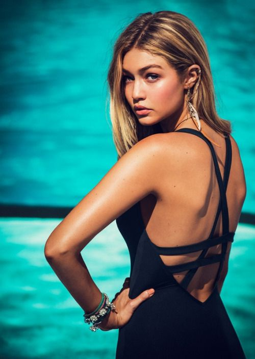 Gigi Hadid  http://www.shoptiques.com/products/seafolly-deep-v-one-piece-1/408970?signalSource=boutique