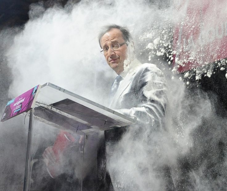 An unidentified woman throws flour on French Socialist Party candidate for the 2012 presidential elections, Francois Hollande, in Paris. (AP)