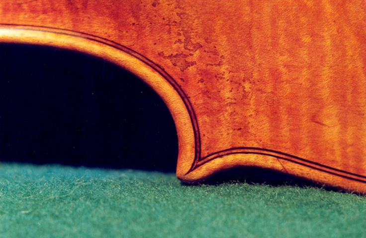 Stradivari's perfectionism is seen in the small details. Here one end of a C.
