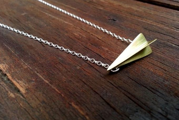 Brass 3D Triangle Necklace by a ring to it